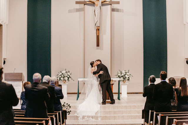 st. margaret mary wedding ceremony bride and groom kissing