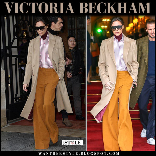 Victoria Beckham in beige coat, orange trousers and striped shirt paris fashion week street style january 18
