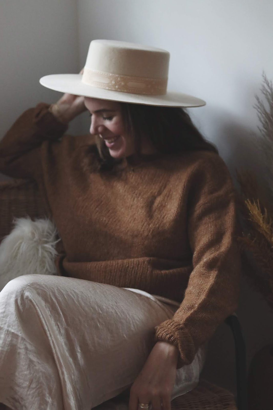 neutral winter outfit lack of color sierra hat aleesha harris
