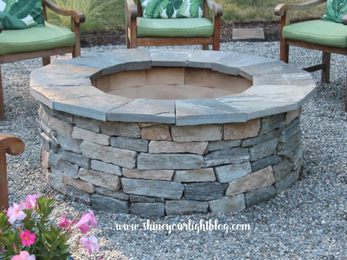adding pea gravel circle with stone firepit