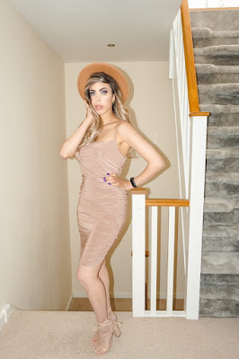 The Femme Luxe Camel Ruched Cowl Neck Bodycon Mini Dress in model Sofie.