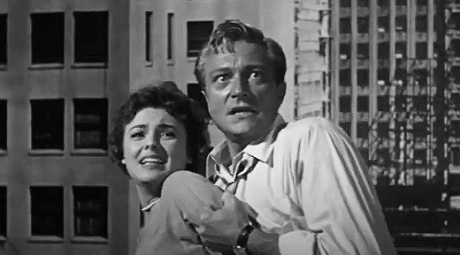 Kathleen Crowley and Richard Denning in Target Earth, 1954