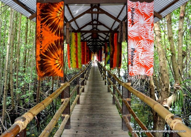 wooden pathway to Badjao Seafront Restaurant