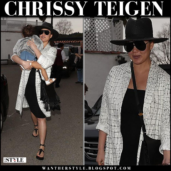 Chrissy Teigen in white printed coat and black dress maternity fashion march 18