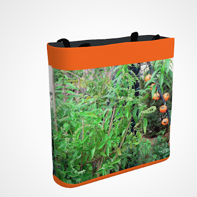 "This screen-shot features an orange tote/bag/pouch which has an image imprinted on it. The picture was taken in my garden when decorated for Halloween. It shows eight little pumpkin outdoor lights amongst the flora. The tote is available in three sizes (13"" by 13"", 16"" by 16"" and 18"" by 18"") and can be purchased via Fine Art America @ https://fineartamerica.com/featured/eight-little-pumpkins-patricia-youngquist.html?product=tote-bag"