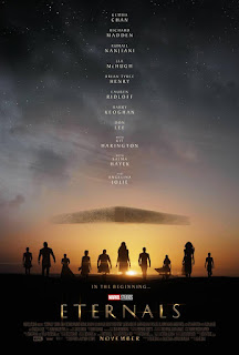 Eternals poster. Group of people in silhouette infront of an orange sky with a slab like space ship in it