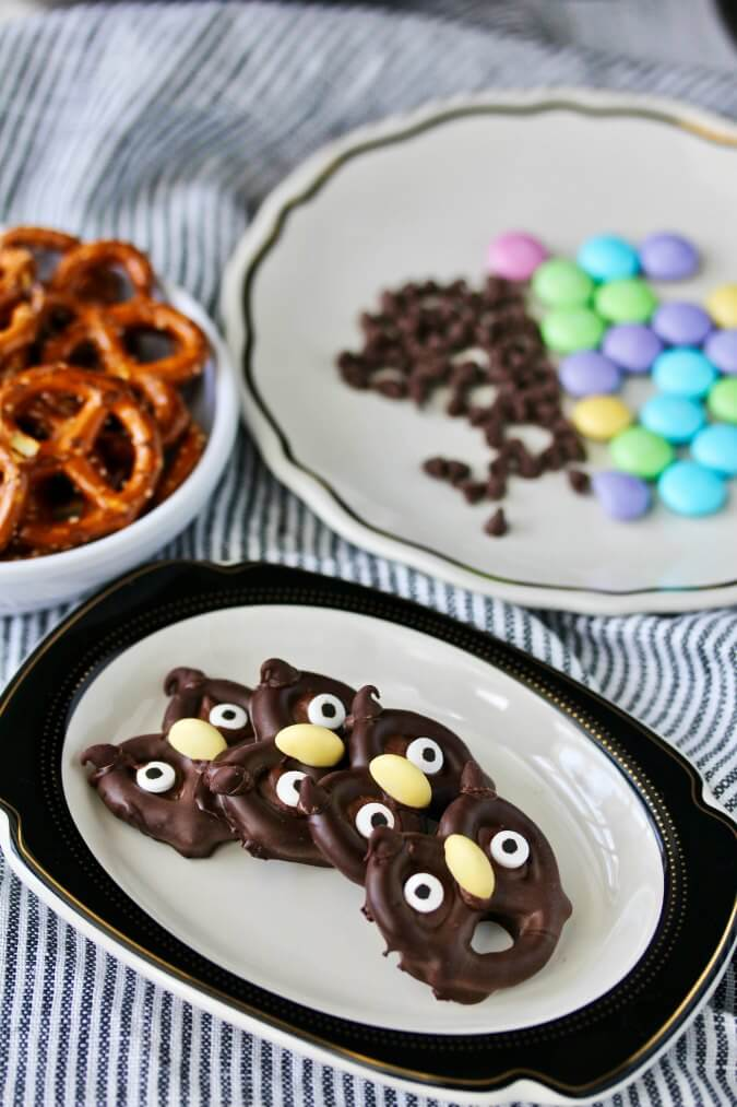Chocolate covered Halloween Pretzel Owls with candy beaks