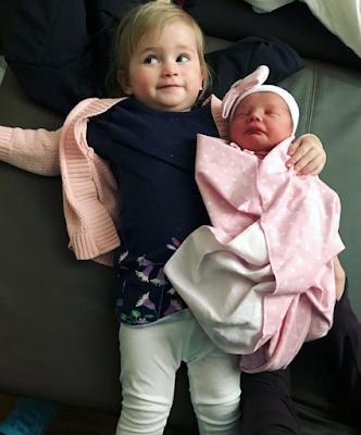Kaci with newborn Everly Paine