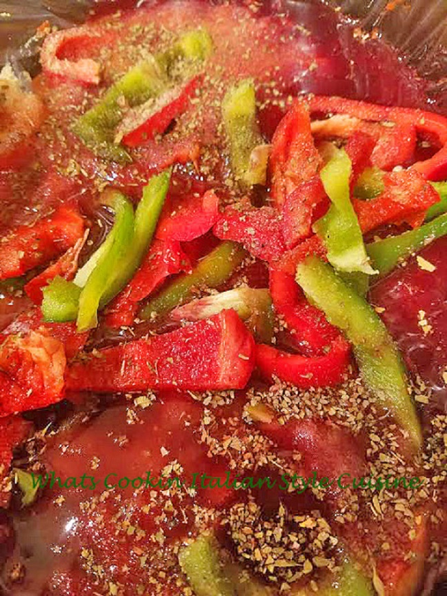 This is a rich Italian bolognese sauce with sausage, sirloin hamburger, tomatoes, with  sliced peppers and garlic on a