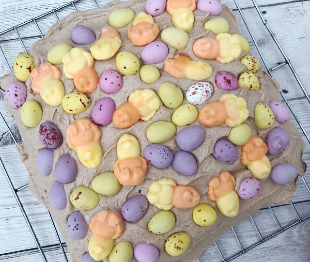 Sponge covered in mixture and chocolate mini eggs and chick sweets