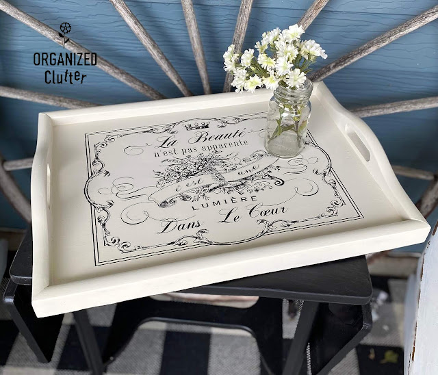 Photo of a serving tray upcycled with drop cloth paint and a decor transfer.