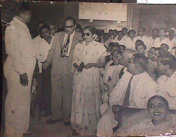 "Dr. Ambedkar at the muhurath ceremony of the Movie ""Mahatma Jyothiba Phule"" made by Acharya Atre at Bombay. With him is seem the Acharya"