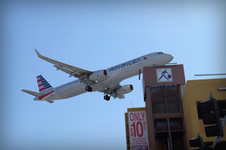 An American Airlines airbus barely clears a parking garage