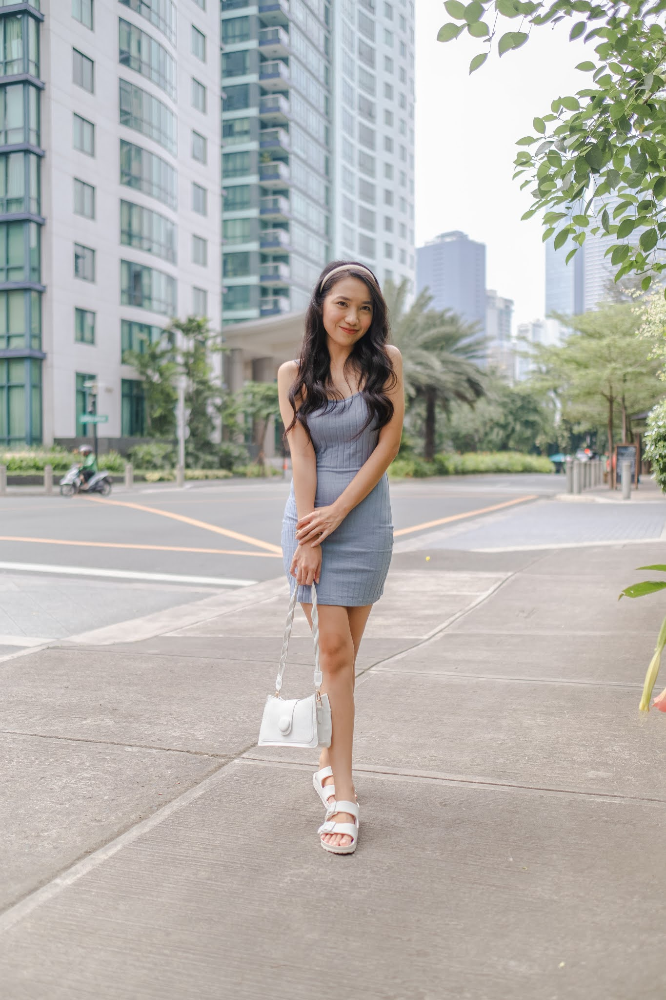 Cielo Fernando at Rockwell Wearing Blue Dress and White Bag