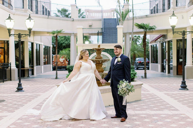 bride and groom in plaza