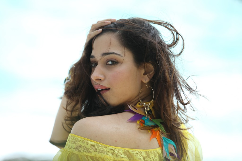 exotic fair and lovely Tamanna hot dancing and spicy stills from thadaka movie