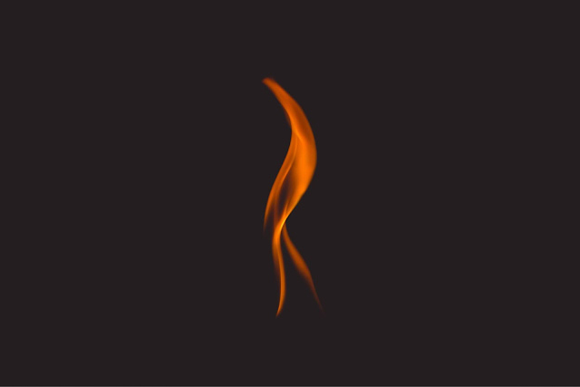 A single tongue of flame against a black field