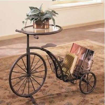model sepeda roda tiga yang berfungsi sebagai meja dan tempat majalah.