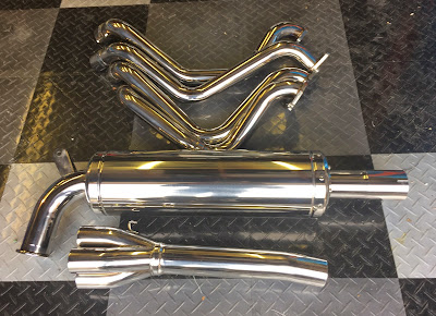 Caterham R500 full exhaust final polish with cotton mop and white compound
