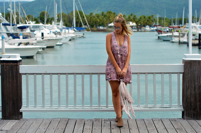 boho print dress styled with ankle boots and fringe statement clutch
