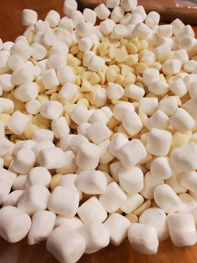 this is marshmallows and white chocolate ready to be melted in a glass bowl in the microwave for Torrone candy making