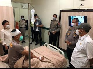 Bupati Batu Bara Kunjungi Kasat Sabhara Di RS Bhayangkara Medan
