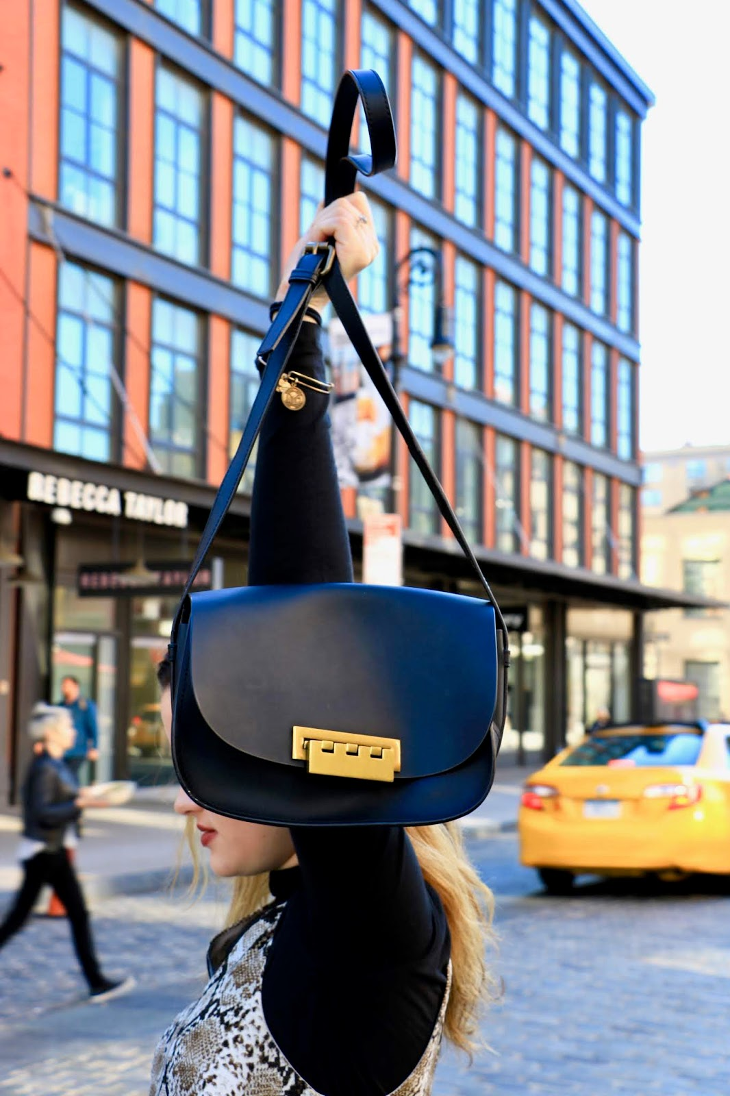 Nyc fashion blogger Kathleen Harper carrying a Zac Posen black crossbody bag.