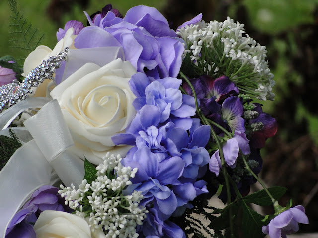 purple and white wedding bouquet with silk flowers the Camellia