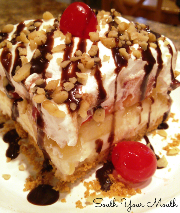 The classic Banana Split Dessert recipe with cream cheese filling, pineapple, strawberries, chocolate syrup and nuts.