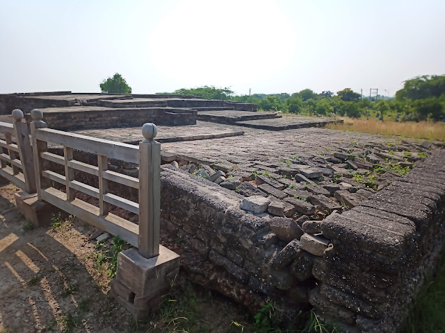 Raised brick structure of upper city of Lothal with a wooden fence next to it