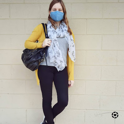 awayfromblue Instagram | blue face mask with mustard cardigan monochrome grey tee black skinny jeans outfit mimco button bag