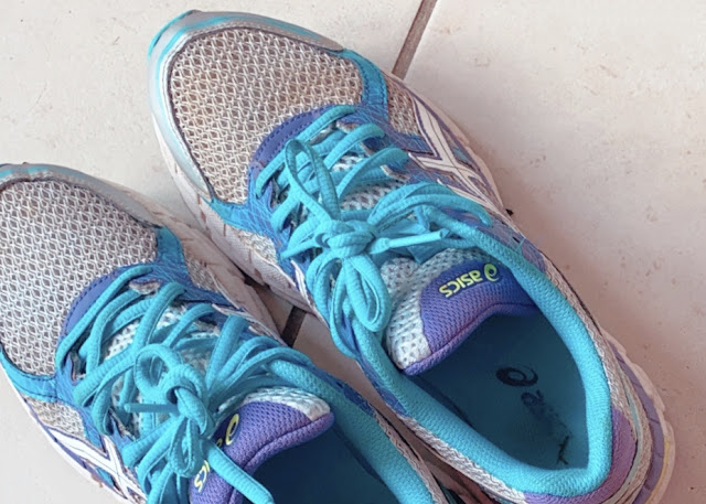 Pair of battered and well used running shoes I have been used for running in lockdown