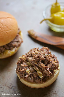 Tangy Slow Cooker Pot Roast Sliders from Yankee Kitchen Ninja featured on SlowCookerFromScratch.com