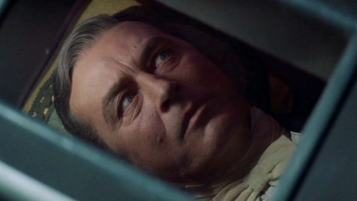 Guy (Ray Milland) is carried away to be buried alive, The Premature Burial (1962)