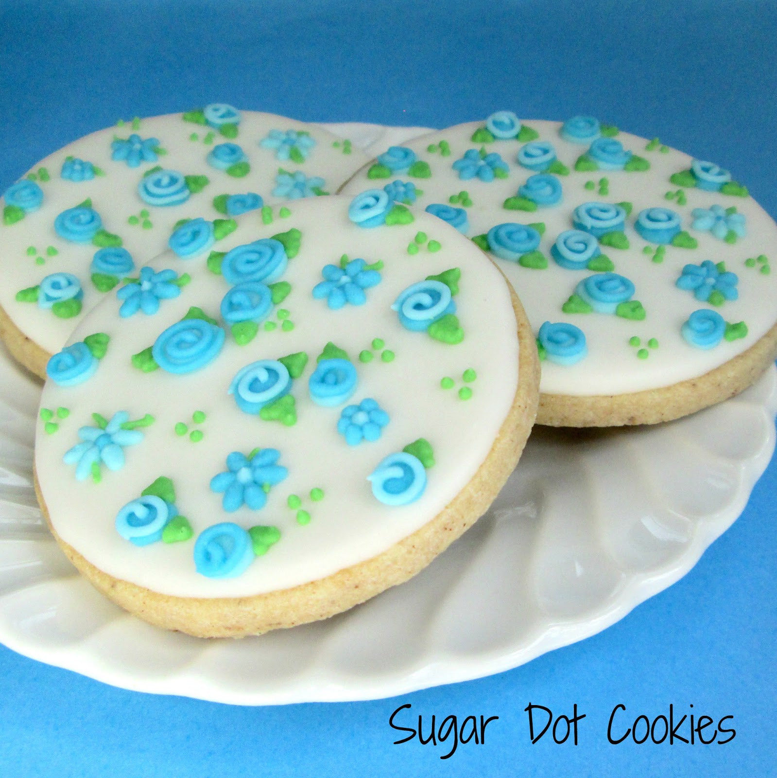 Simple Flowers And Leaves On Plain Round Cookies