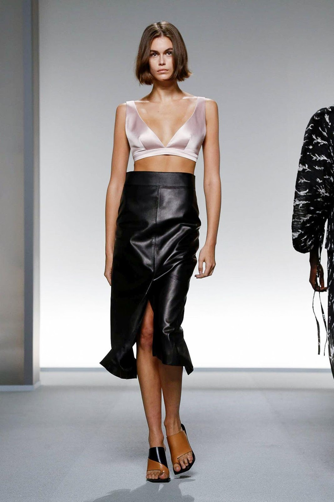Kaia Gerber debuts her Beatles-inspired tattoo and flaunts her incredible figure in a TINY satin pink bralet as she walks for Givenchy's PFW show