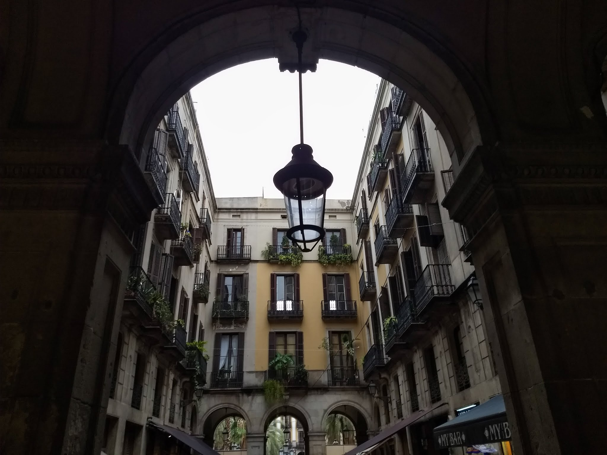 Under an archway in the Passatge de Madoz in Barcelona, Spain.