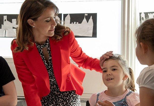 Princess Marie wore Alexander McQueen Flared-hem Crepe Jacket and the Princess carried Carlend Copenhagen clutch at Autism school