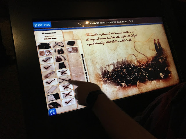 Image of Ben using an interactive display at the Gettysburg museum
