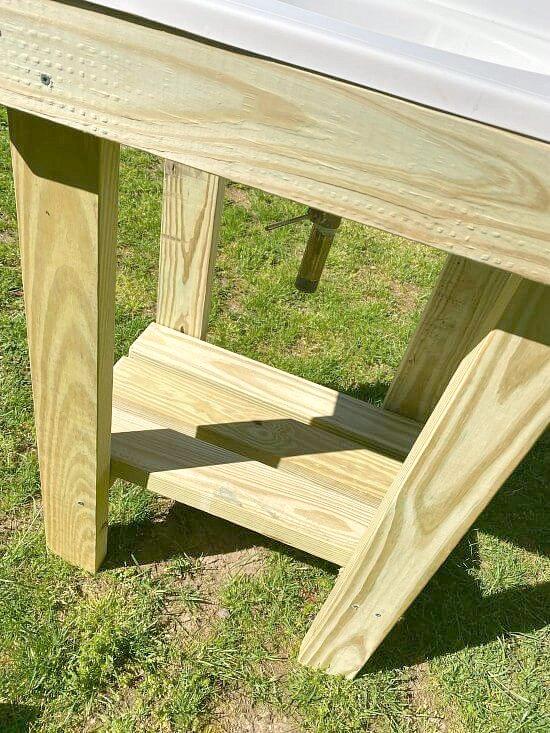 Pressure treated wood frame with shelf