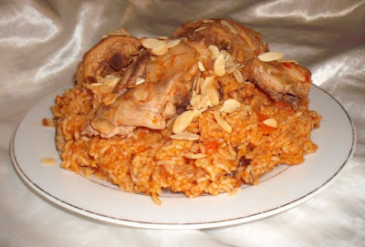 simmer over a low heat for a couple of minutes Al Kabsa - Traditional Saudi Rice & Chicken Dish Recipe