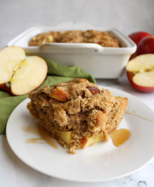 serving of whole wheat buttermilk apple cake on plate waiting to be eaten for breakfast