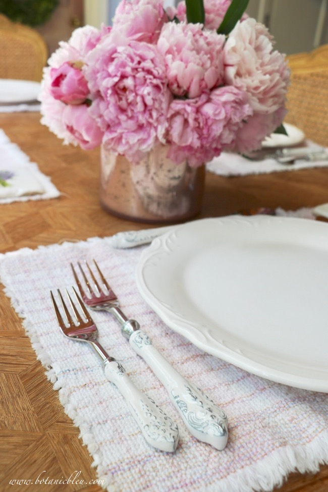 French country early summer table setting with white enamel scroll flatware