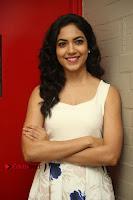 Actress Ritu Varma Stills in White Floral Short Dress at Kesava Movie Success Meet .COM 0094.JPG