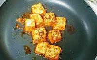Roasting paneer Tikka on tawa or pan for the recipe of paneer tikka masala