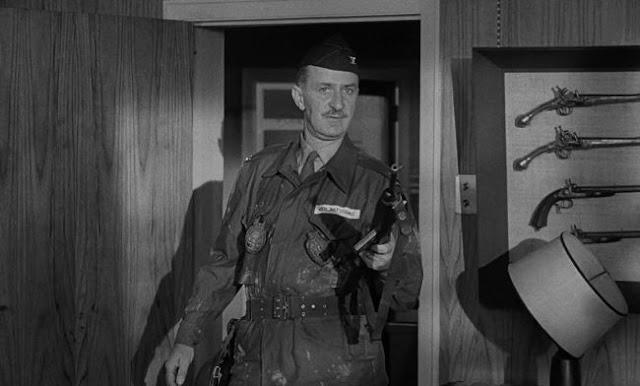 "Keenan Wynn as Colonel ""Bat"" Guano"
