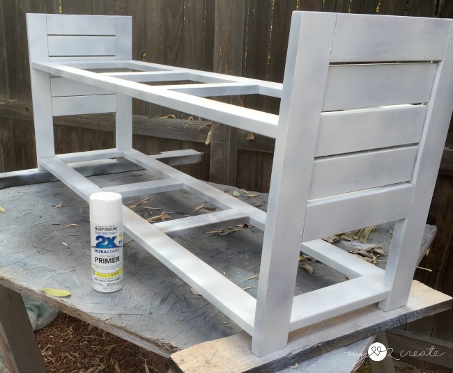 priming the bench with rustoleum's spray paint primer
