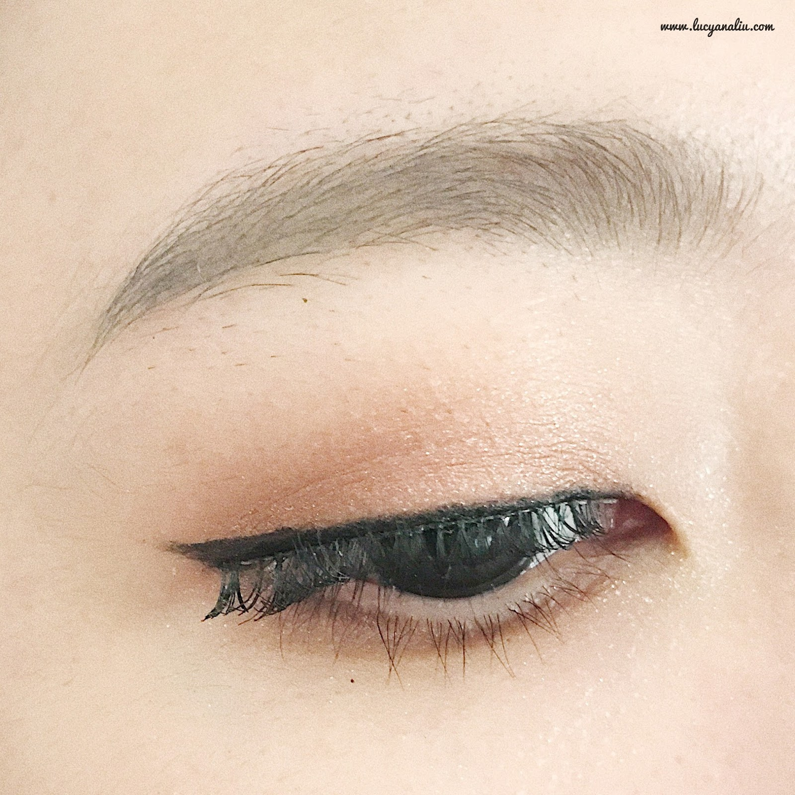 I m using spring pink eye shadow all over the lid and using soft brown eye shadow to the outer corner Using sunshine peach to the inner corner of the