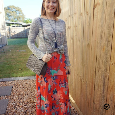 awayfromtheblue Instagram | knotted grey jumper tied at waist over printed maxi dress in winter