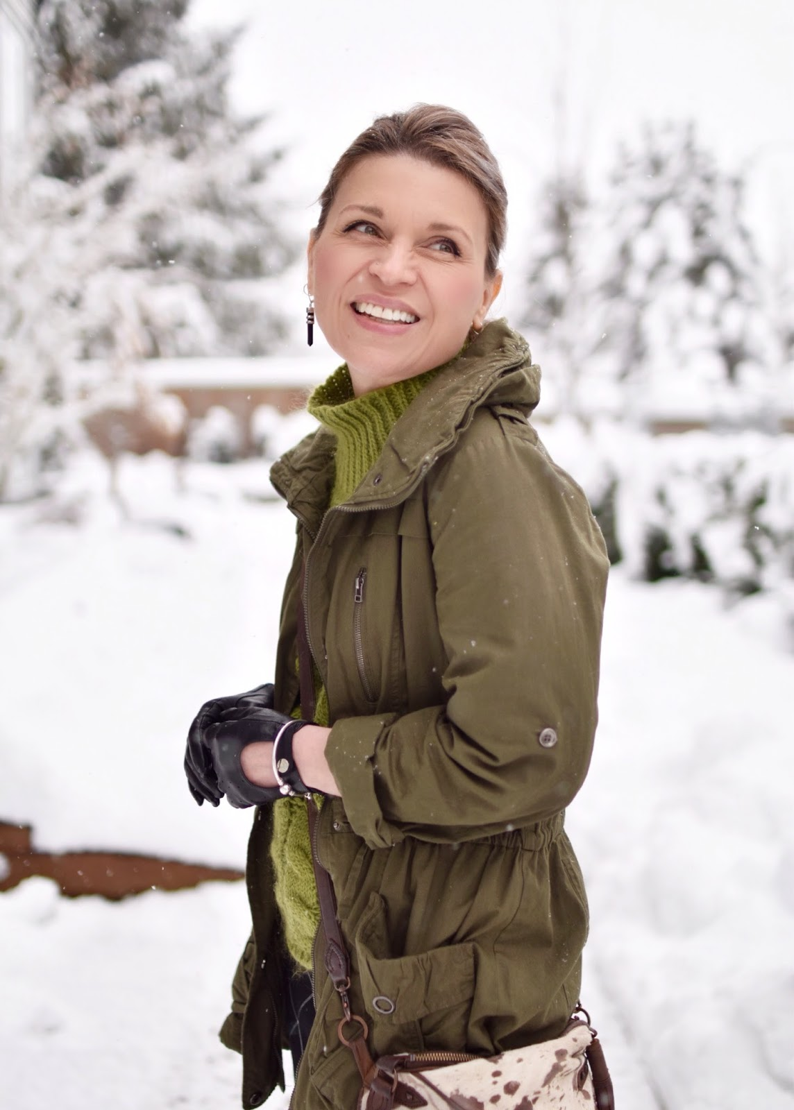 Monika Faulkner outfit inspiration - green mohair sweater, army-inspired parka, driving gloves, cross-body bag
